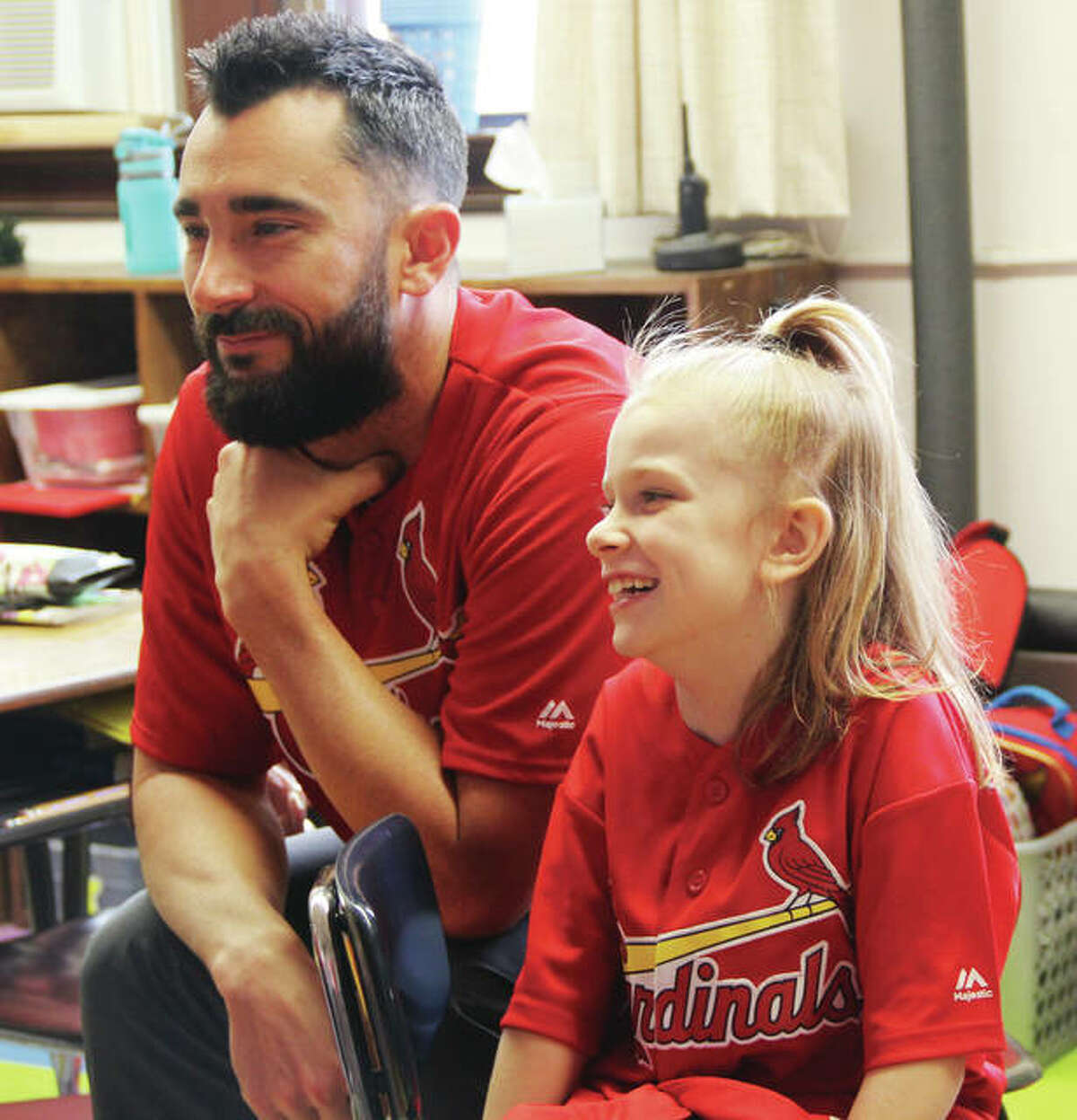 Matt Carpenter and Jocelyn Thomas chat Friday morning in her second-grade classroom. Thomas, who won a contest sponsored by Academy Sports to bring Carpenter to school, could barely contain her excitement at meeting her favorite baseball player.
