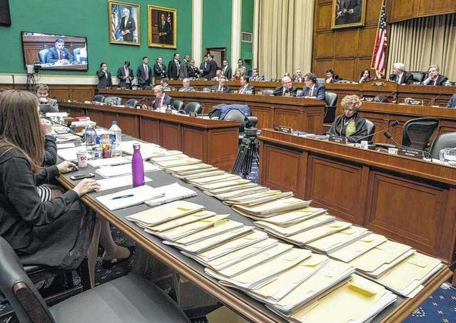 J. Scott Applewhite | AP Folders containing amendments to the GOP's Affordable Care Act replacement bill are spread on a conference table on Capitol Hill in Washington as members of the House Energy and Commerce Committee worked through the night.