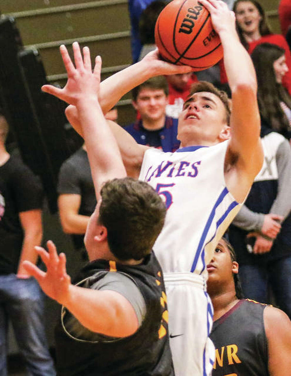 Carlinville's Aidan Naugle (middle) puts up a shot between EA-WR defenders during a nonconference game Dec. 2 in Carlinville. The Cavaliers were back at home Saturday for a SCC matchup won by the Pana Panthers.