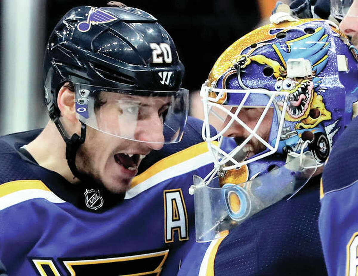 The Blues' Alexander Steen (left) congratulates goalie Carter Hutton after the Blues shut out the Winnipeg Jets on Saturday night in St. Louis.