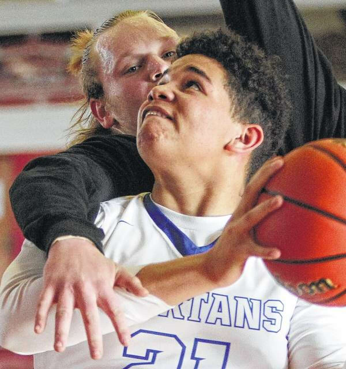 North Greene's Zion Thomas (front) is fouled during a game against Edinburg on Saturday in the Jacksonville Prep Showcase at The Jacksonville Bowl.