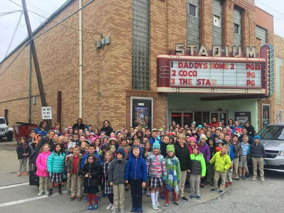 """The student body of Holy Ghost Catholic School stood outside the Stadium Theater in Jerseyville Thursday. All the students had performed acts of kindness, which entitled them to watch the film """"The Star"""", about the birth of Jesus."""