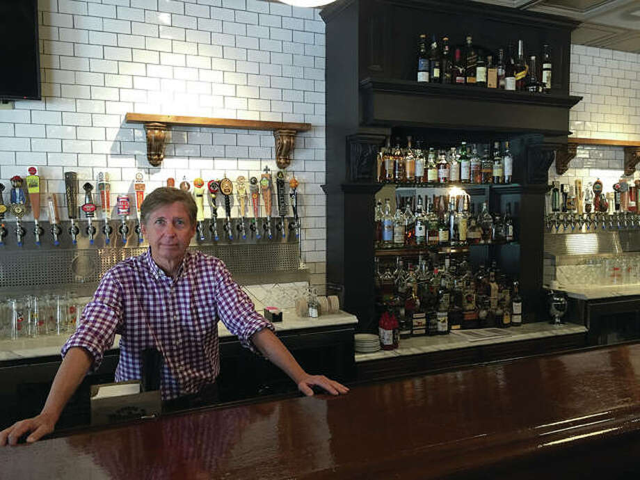 In this June 2015 photo, Russ Smith stands behind the bar of Elijah P.'s. Smith announced on Facebook Monday that the restaurant will close its doors Dec. 31, less than three years after its opening. Photo: Nathan Grimm | The Telegraph