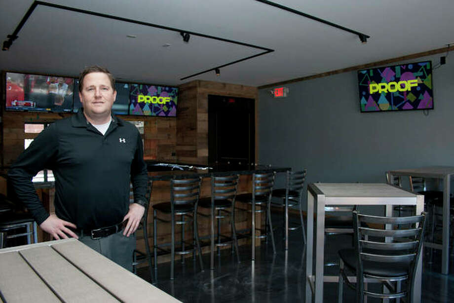 Jerrod Capps, an owner of the new high-end tavern Proof, stands on the second floor of the Jerseyville establishment. An outdoor patio to the front gives patrons a big view over the town.