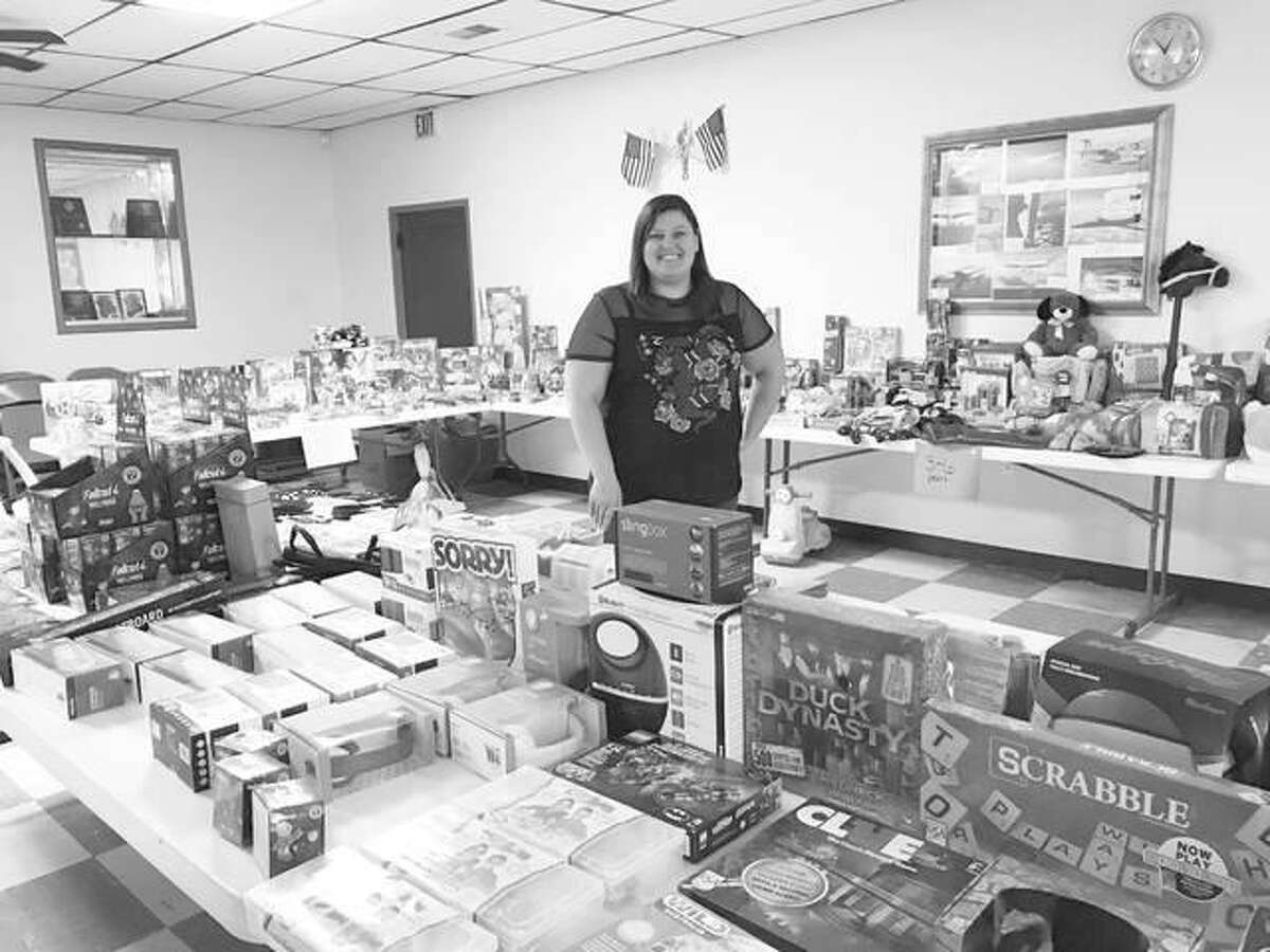 Savanna Bishop, founder of the group Mid-Town Moms, purchases toys and collects donations throughout the year to give back to the community at their annual event during the Christmas season. This year was her fourth year organizing the event for families in need.
