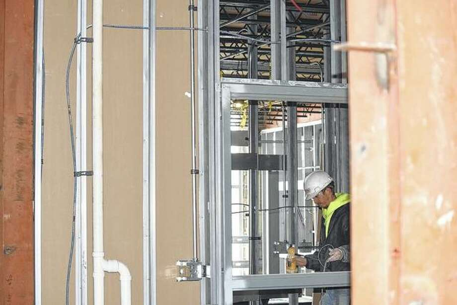 Workers continue framing, electrical and plumbing work Monday on the west side of Turner Junior High School. Photo: Samantha McDaniel-Ogletree | Journal-Courier