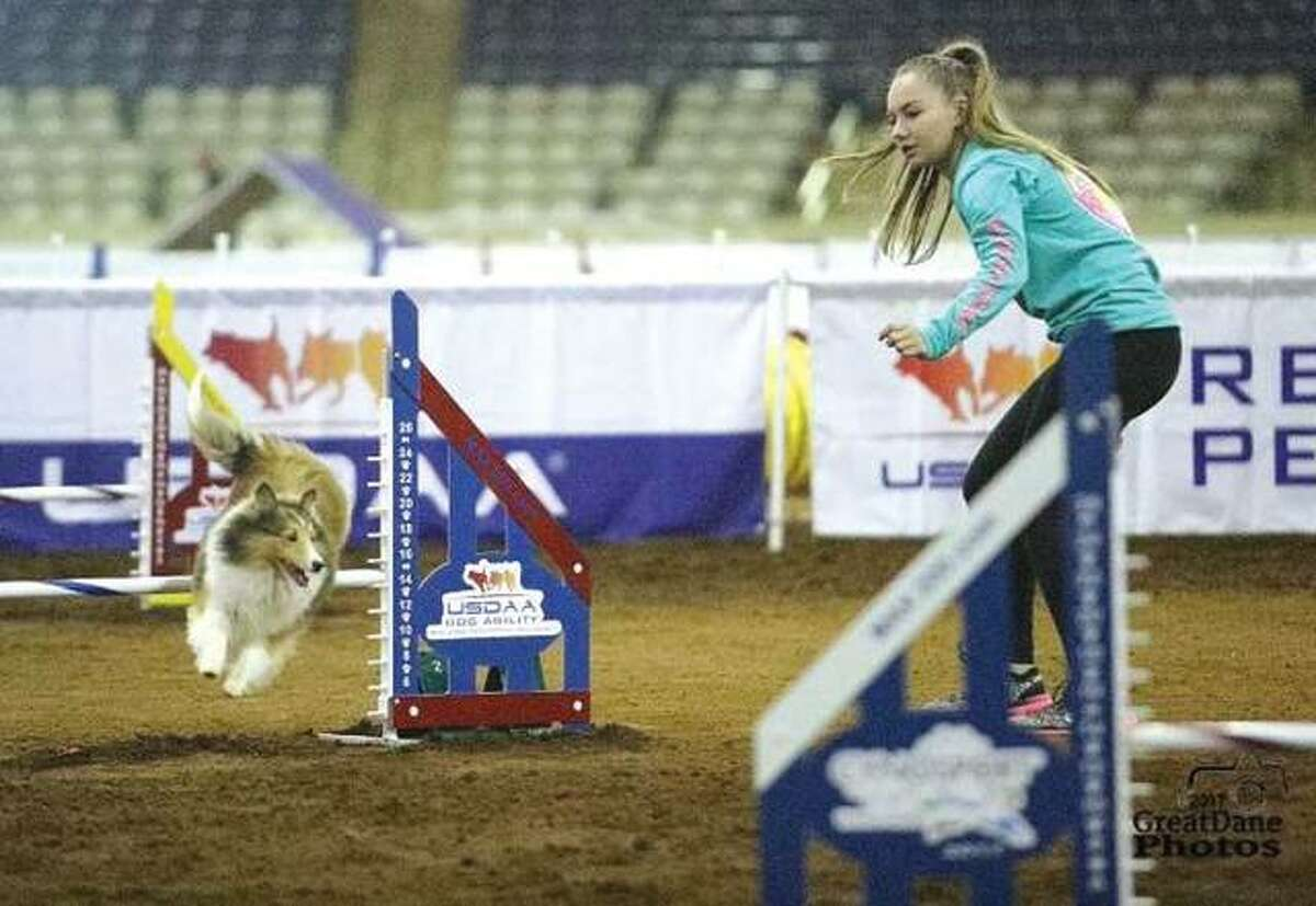 Lydia Carnes works with Bella in a competition arena.