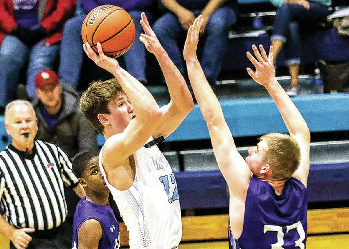 Kurt Hall of Jersey, left, puts up a jump shot over Mascoutah's Tyler Jowett in Tuesday's 64-56 Mississippi Valley Conference loss at Havens Gym. Hall led the Panthers with 22 points, including five three-pointers.
