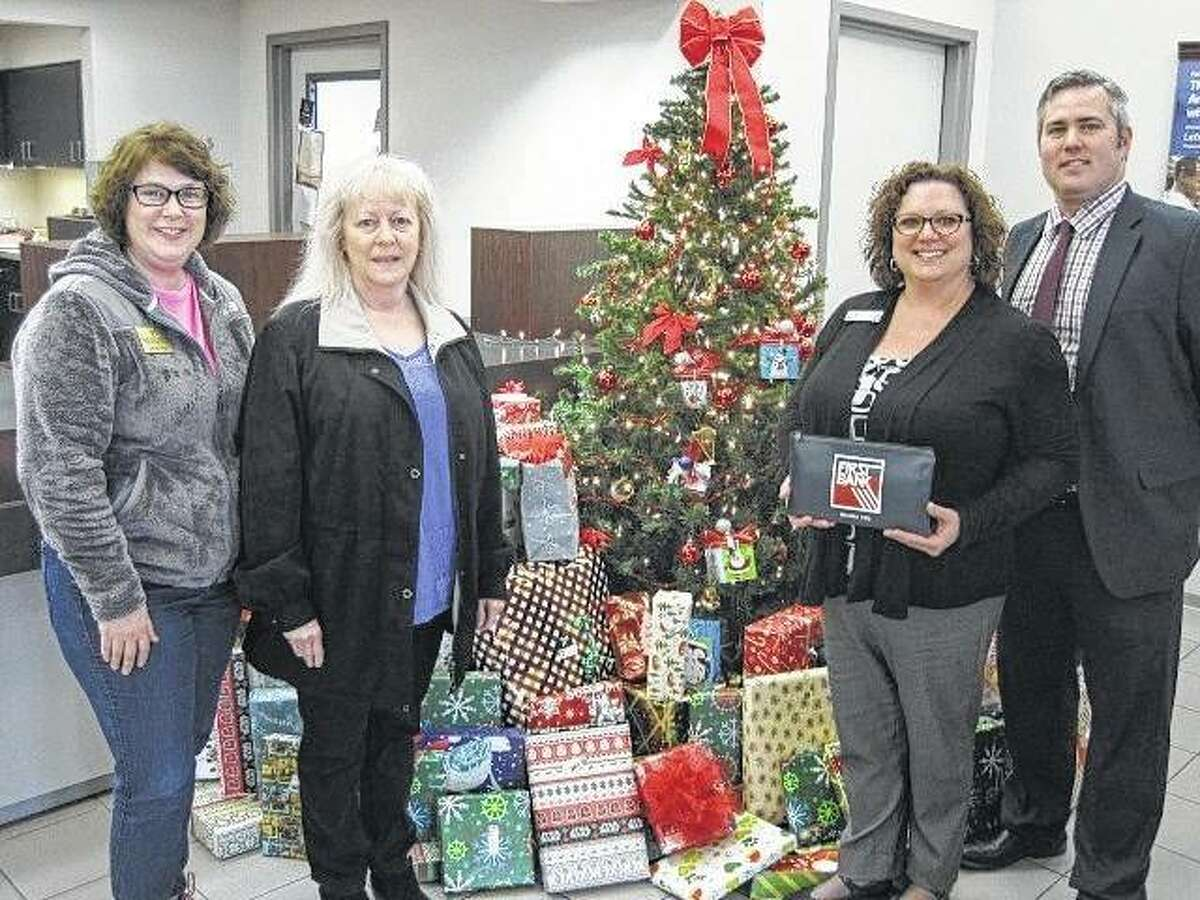 From left, Jenny Vogel and Nancy Rivera of Big Brothers Big Sisters of Southwestern Illinois with First Bank's Carrie Mackey and Doug Brantley.