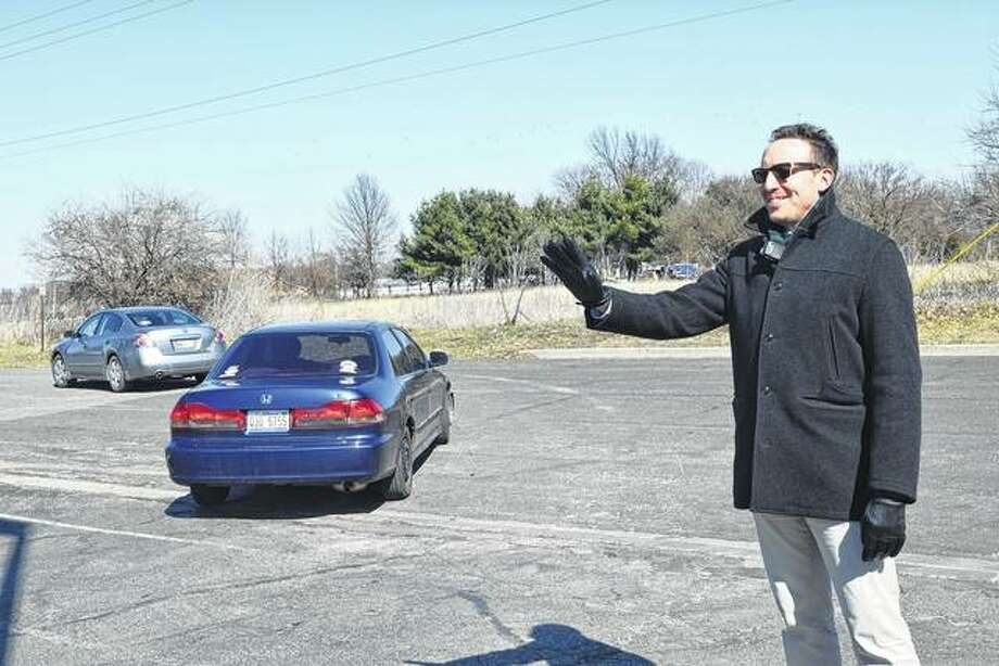 Jacksonville High School Assistant Principal Tim Chipman directs traffic Wednesday after school. Chipman was named the Illinois Assistant Principal of the Year.