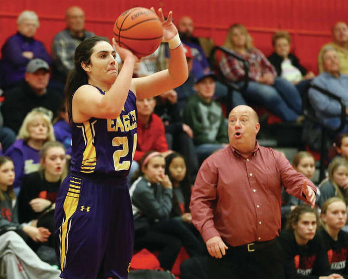 CM's Kaylee Eaton gets open for a baseline 3-pointer while Highland coach Mike Arbuthnot (right) reacts to the defensive breakdown from the bench Wednesday night in Highland.