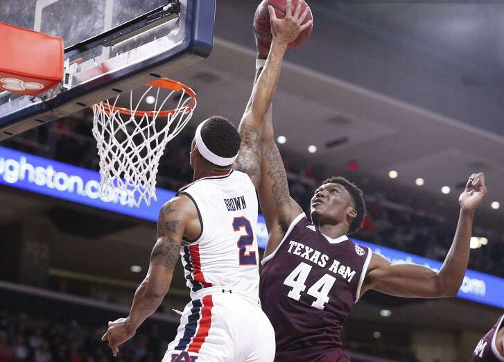 Texas A&M forward Robert Williams stops Auburn guard Bryce Brown from scoring during the first half of an NCAA college basketball game on Wednesday, Feb. 7, 2018, in Auburn, Ala. (AP Photo/Brynn Anderson)