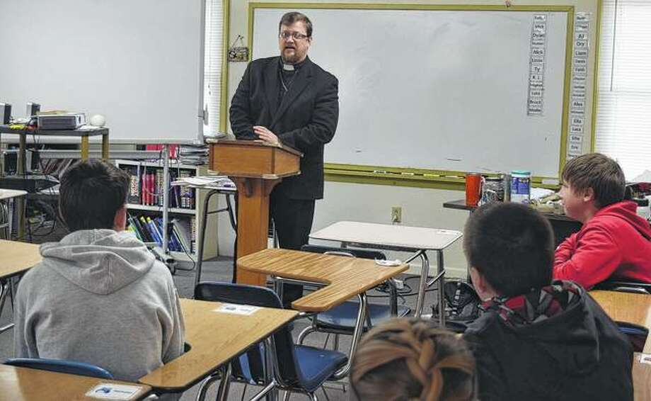 Pastor William Orr speaks to a group of students from Salem Lutheran School on Thursday. Photo: Samantha McDaniel-Ogletree | Journal-Courier