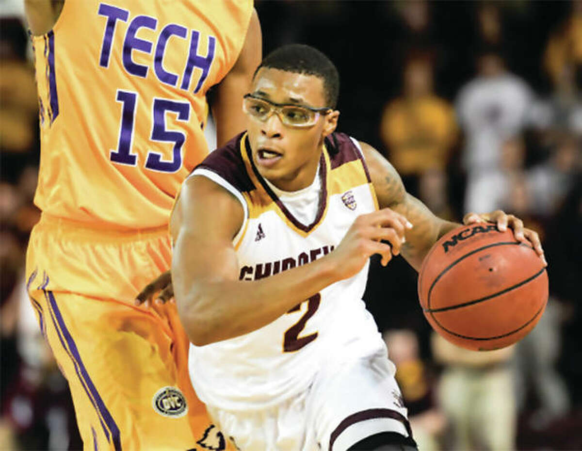Central Michigan's Shawn Roundtree Jr. (right) drives past a Tennessee Tech defender during a Dec. 9 game at Mount Pleasant, Michigan. Roundtree, a junior from Edwardsville leads the 9-2 Chippewas in scoring and rebounding, will take on the visiting SIUE Cougars on Friday night.