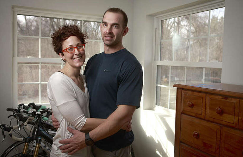 Zia Nizami | Belleville News-Democrat (AP) Dawn and Rob Blum at their home in Collinsville. Dawn Blum took dozens of photos out her bedroom window, one every day that her military husband was stationed overseas. The idea was to document or illustrate the passage of time.