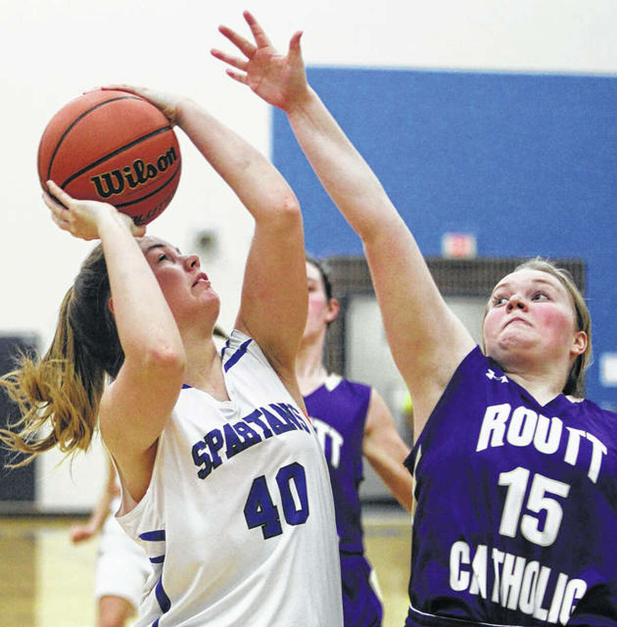 North Greene's Bree Barnard puts up a shot contested by Jacksonville Routt's Mallory Martin (15) defends during WIVC girls basketball game Thursday night in White Hall. Routt won to push its record to 14-2.