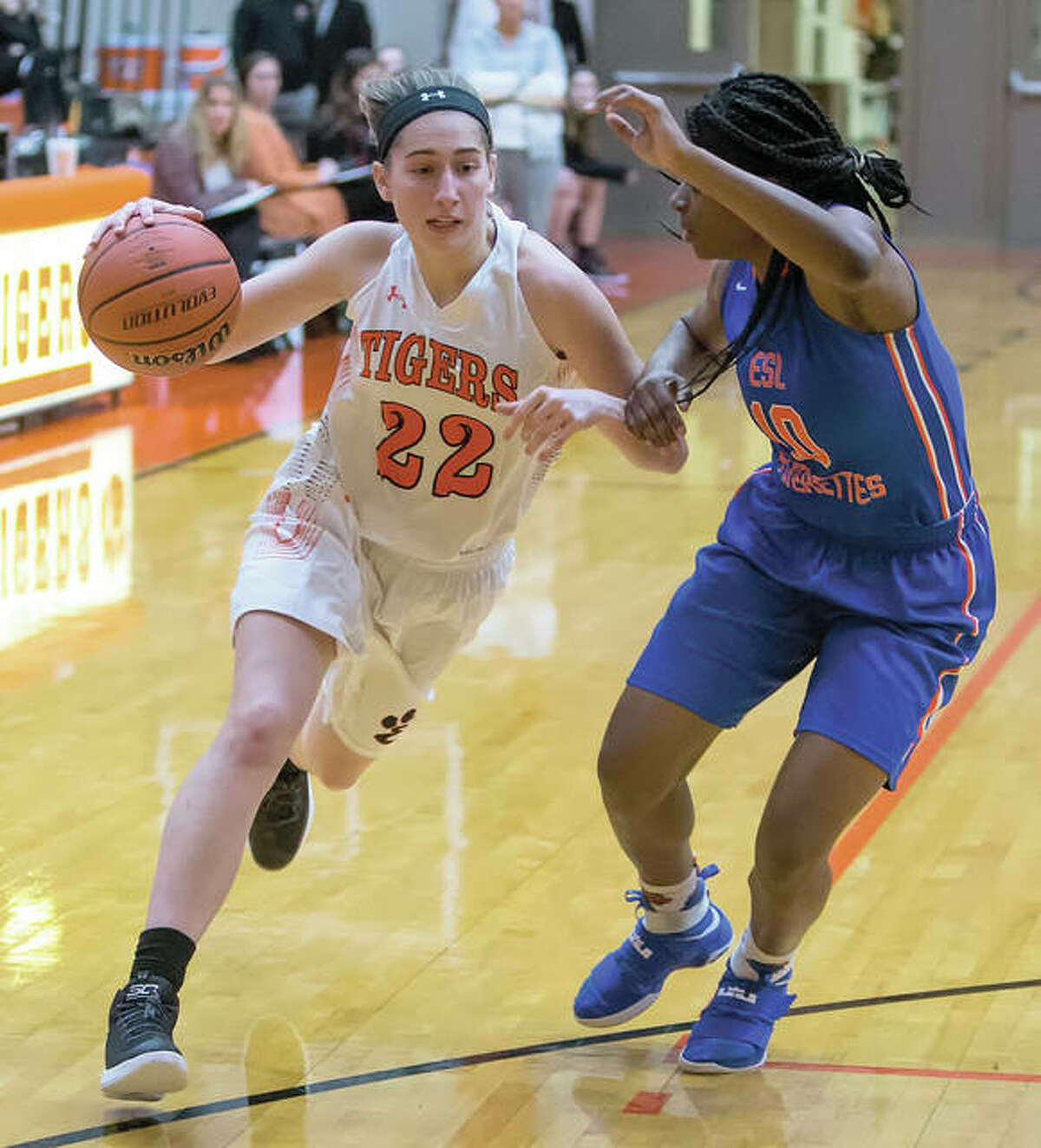 Edwardsville's Kate Martin (left) drives on East St. Louis' Rokelle Stanley during the Tigers' SWC girls basketball victory Wednesday night at Lucco-Jackson Gym in Edwardsville. The 6-foot Martin, signed with Iowa, will be one of many Division I recruits in the 16-team field at the prestigious Visitation Christmas Tournament starting Saturday in St. Louis. The 10-0 Tigers, making their debut in the tourney, are the No. 2 seed.