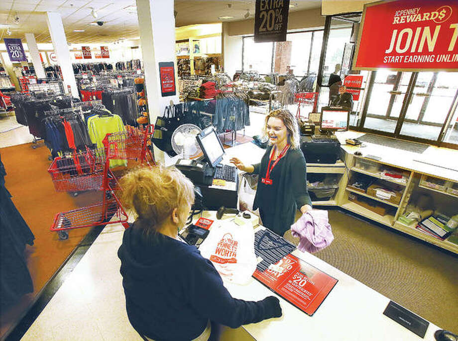 In this photo from March, happy sales associate Shelby Sasek waits on a customer at the JCPenney store in Alton Square Mall after company officials announced the Alton location wasn't among those it was eyeing for closure. After it was made public Thursday that a St. Louis location would be closing in January, a company spokesman confirmed Friday that the Alton store is staying open. Photo: John Badman | The Telegraph