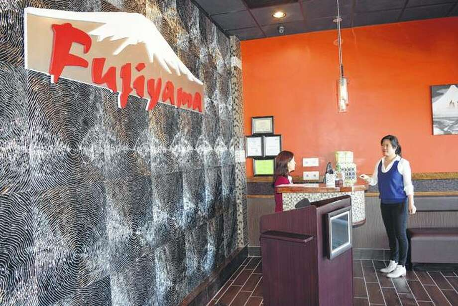 "Fujiyama Japanese Steakhouse opens at noon today at 1233 W. Morton Ave., next to Buffalo Wild Wings. Co-owners Winnie Zhao (left) and Lisa Weng speak Saturday at the new restaurant's front counter. ""We think that people will really enjoy the experience of our hibachi grills,"" Weng said. Photo: Greg Olson 