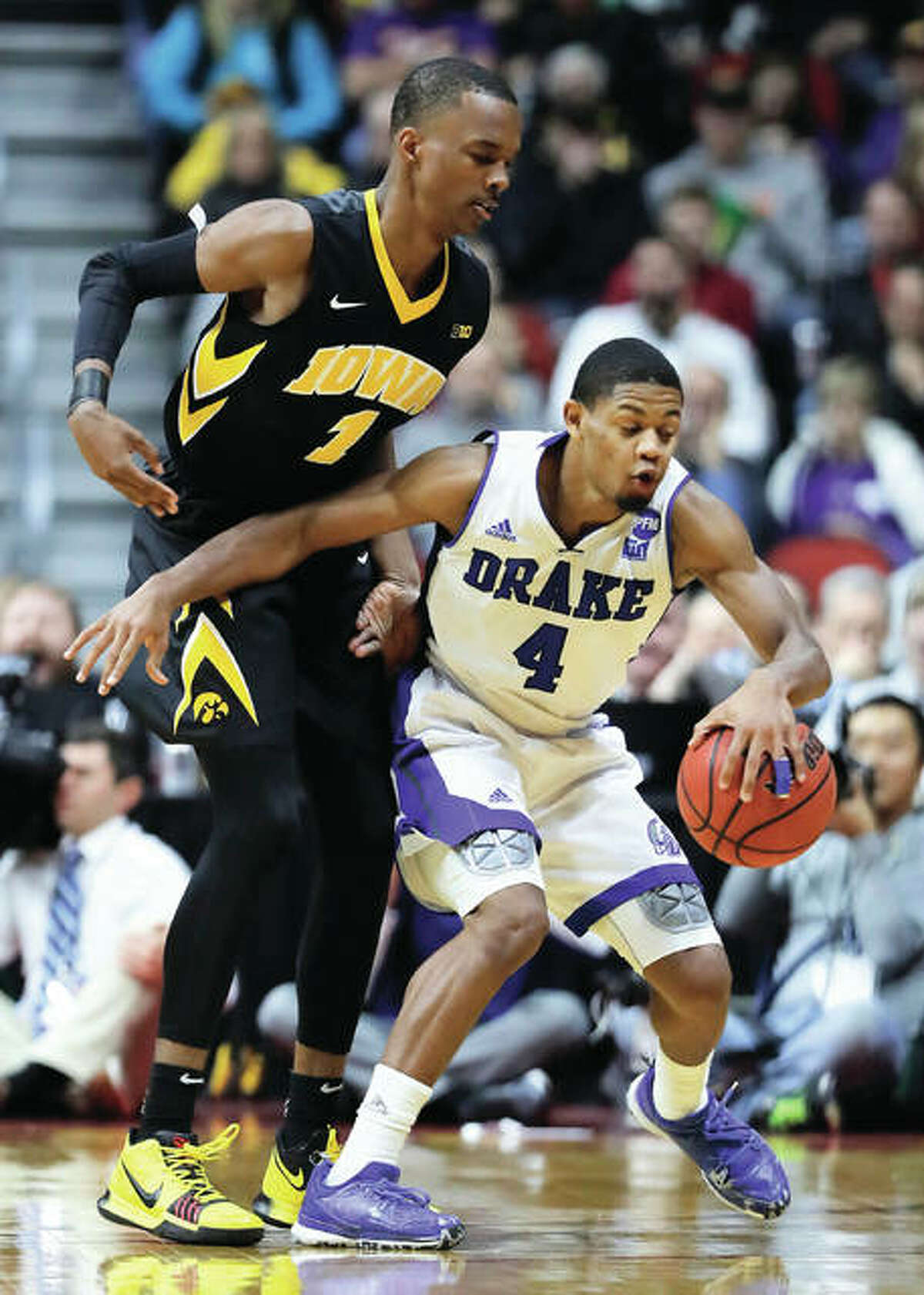 Drake guard De'Antae McMurray (4), a senior from Alton, drives around Iowa's Maishe Dailey during a NCAA college basketball game Dec. 16 in Des Moines, Iowa. Iowa won 90-64. On Friday night back in Des Moines, the 6-foot-2 McMurray scored 16 points in the Bulldogs' 81-57 victory over Maryland Eastern Shore that snapped Drake's three-game losing streak. McMurray is second on the team in scoring at 12.0 points per game. The former prep standout at both Marquette Catholic and Alton high schools is shooting 40 percent from 3-point range and has scored in double figures in each of Drake's last four games. The 6-7 Bulldogs open Missouri Valley Conference play at home on Thursday against Bradley.
