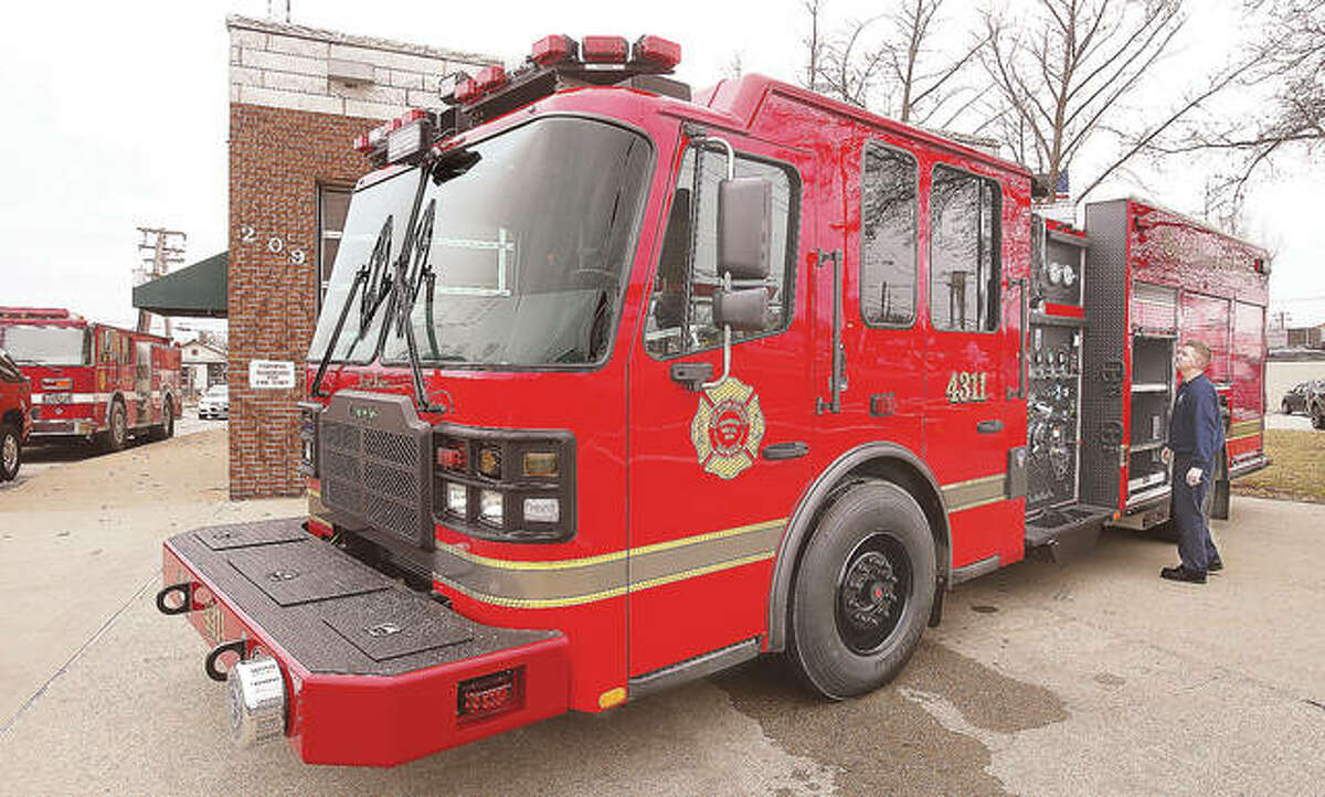 In this photo from January, East Alton firefighters get acquainted with their brand new Ferrara Fire Apparatus rescue-pumper style truck. It replaced a 20-year-old Pierce built truck, left, which has since been in storage. Now, the village has approved the purchase of equipment for the new truck that will allow for the Pierce pumper to exist as a reserve, the first time in a long time - possibly ever - the village has had a reserve pumper.
