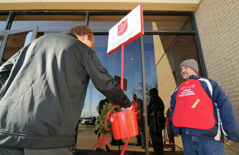Dane Rockafellow thanks a Red Kettle Campaign donor at the Alton Square Mall. Photo: David Blanchette | For The Telegraph