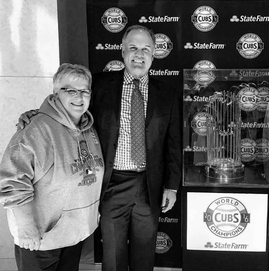 Janet Rucks of South Jacksonville, a longtime Chicago Cubs fan, poses with Cubs Hall of Famer Ryne Sandberg and the Cubs' 2016 World Series trophy March 8 at the Abraham Lincoln Presidential Museum in Springfield.