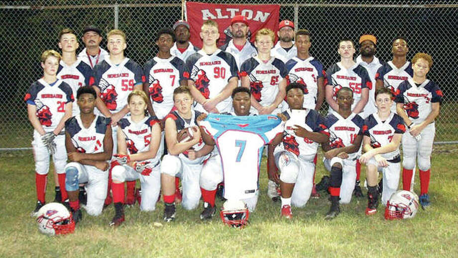 The Alton Renegades Under-14 Turbyfill football team won the championship at the Pro Football Hall of Fame National Championships in Canton, Ohio. Players included (front from left): Donomique Fulton, Mikey Bridgeman, Damion Swegeart, Jordan Icke, Kobe Sanders, Jaelyn Telford, Alex Tinker, Collin Felton and Kauron Parchmon. Back from left: Sam Rakoski, Matt Mayer, Gage Depew, Chris Johnson, Logan Turbyfill, Michai Hubbard, Jaelyn Byrd, Elijah Griffin, Connor House and Gary Barbour. Coaches, from left: Dave Turbyfill, Josh Pochek, Eric Smith, Justin Teleford, Donte Killebrew, Jeremy Elledge and Donnie House. Photo: Submitted Photo