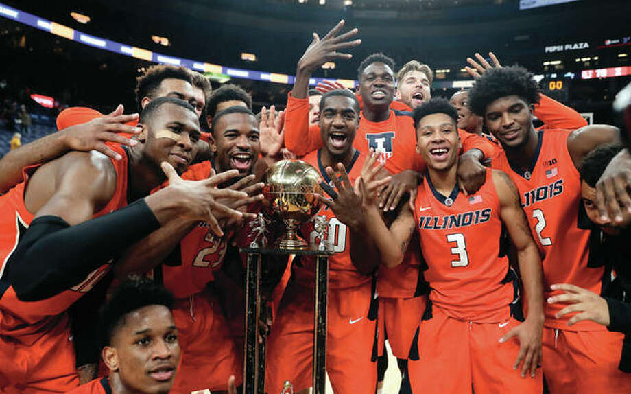 Fighting Illini players signal a fifth straight victory in the Braggin' Rights rivalry after defeating Missouri on Saturday night in St. Louis. Illinois won 70-64. Photo: Associated Press