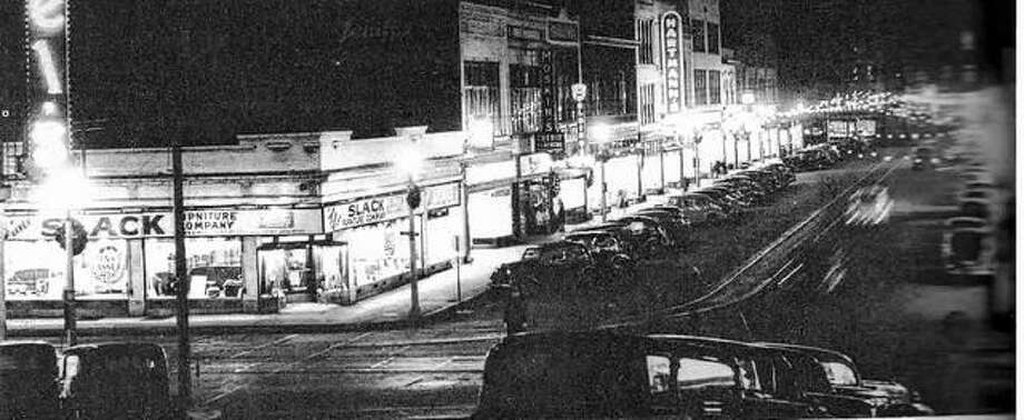 "In December 1939, West Third Street was decorated for Christmas, and parking was at a premium on the busy street. Downtown of that day had a variety of retail shops, professional offices, and restaurants. The merchants organization, Downtown Alton Incorporated, was fond of saying ""you can get it all downtown."" Dependable streetcar service made it possible for everyone to go downtown. Photo: File Photo"