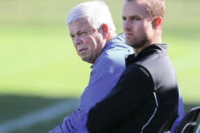 LCCC coach Tim Rooney (left) and assistant Ryan Hodge look on from the sideline during a Trailblazers match last season. Rooney, who will have the soccer stadium at LCCC named in his honor, has retired. Hodge is stepping in as men's coach, and possibly women's coach, next season.