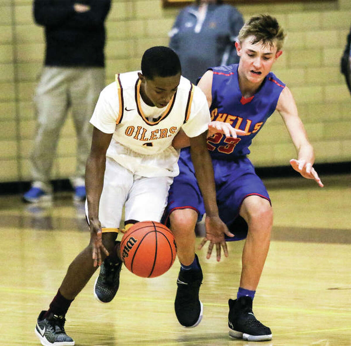 EA-WR's Tavion Walker (left) beats Roxana's Gavin Huffman to the ball during a game Dec. 8 at Memorial Gym in Wood River. The Shells, who open holiday tourney play at the Duster Thomas Classic in Pinckneyville on Friday, are 2-7 in a rebuilding season that has freshman playing major roles.