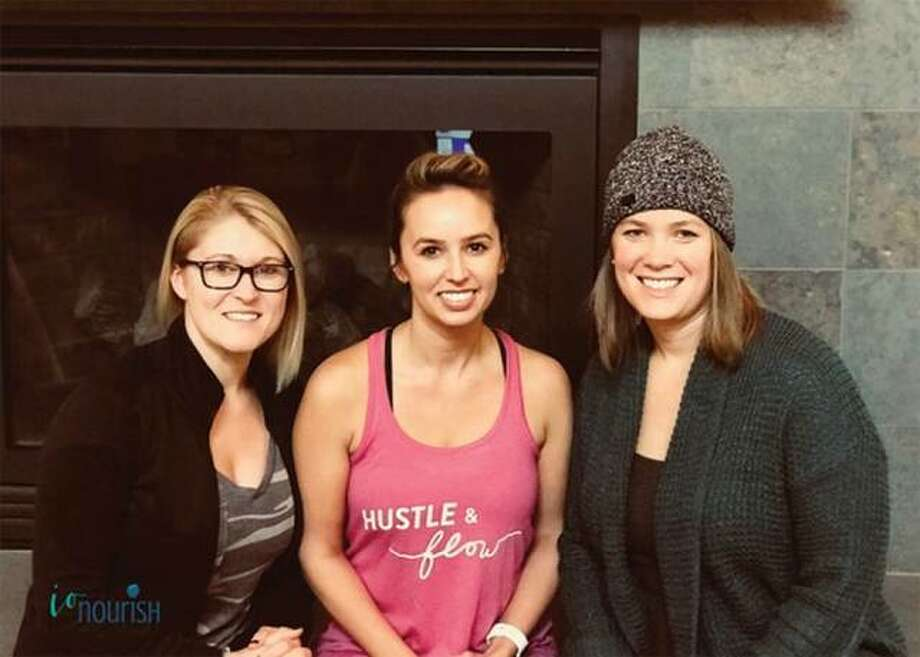 Iron Orchid Studio owners Christal Laswell, left, and Bree Barnes with nutrionist Kelsey Albers. Photo: For The Telegraph