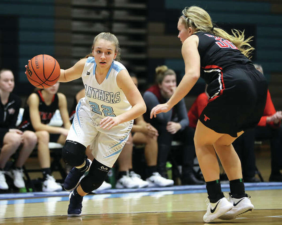 Jersey's Clare Breden (left) drives past Triad's Ali Barisch on her way to the hoop during a Mississippi Valley Conference girls basketball game Dec. 14 at Havens Gym in Jerseyville. Breden, a freshman, leads the 9-3 Panthers in scoring.