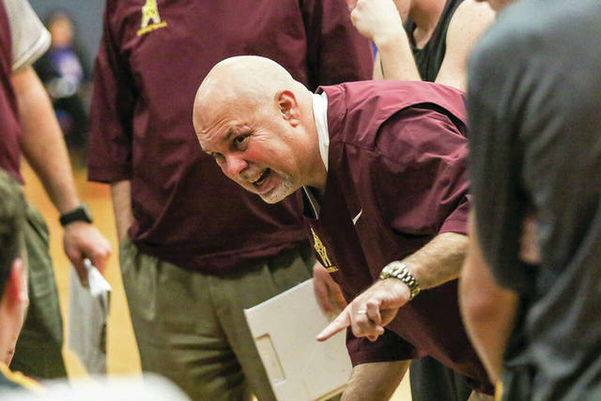 East Alton-Wood River coach Ron Twichell instructs his team during a break in the Oilers' victory over the Shells earlier this month at Memorial Gym in Wood River. EA-WR opened play at the Carlinville Tourney on Tuesday with a loss to the Staunton Bulldogs.