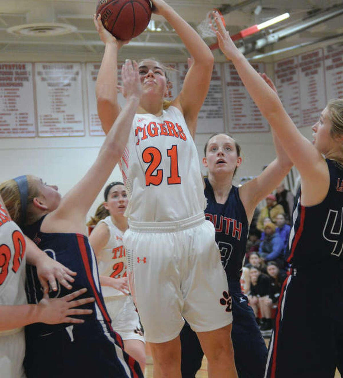 Edwardsville's Rachel Pranger (21) goes up in traffic for a shot during a first-round game Saturday against Parkway South in the Visitation Tournament in St. Louis. The Tigers were back at Viz on Tuesday and got 16 points in a 61-23 quarterfinal victory over Washington, Mo.