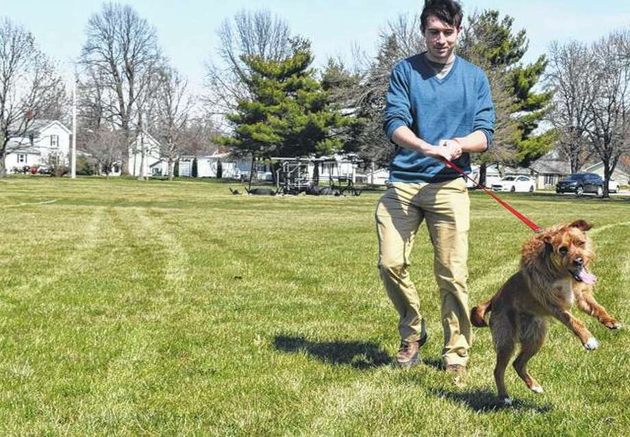 Thomas Estabrook of Jacksonville walks his dog, Watson, on the Illinois School for the Deaf campus Tuesday. Photo: Journal-Courier