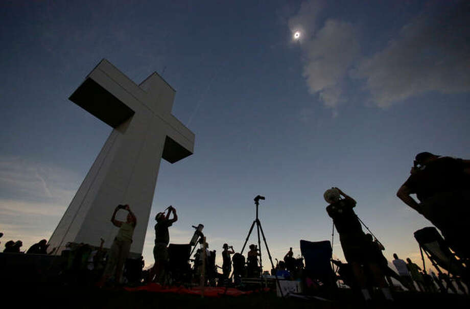 In this Aug. 21, 2017 file photo, a total solar eclipse is seen above the Bald Knob Cross of Peace in Alto Pass, Ill. More than 700 people visited the over 100 foot cross for the event. The first total solar eclipse to sweep coast-to-coast across the U.S. in 99 years drew hundreds of thousands of people to areas of southern Illinois located in the path of totality, where the sun is 100 percent blocked by the sun. The story was chosen as one of Associated Press year's 10 biggest stories or 2017 in Illinois. Photo: AP Photo/Charles Rex Arbogast File