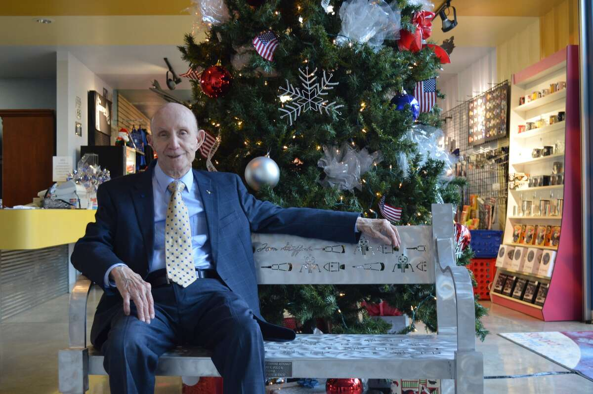 Lt. Gen. Thomas P. Stafford, a retired astronaut and test pilot from NASA's Apollo and Gemini years, sits on a bench designed by Kelly Gale Amen and installed in an air and space museum in their hometown of Weatherford, Okla. The bench is laser cut with images of spacecraft drawn by Stafford. When Stafford wanted to sell his Old Town Alexandria, Va., home, he asked Amen to spruce it up to sell it.