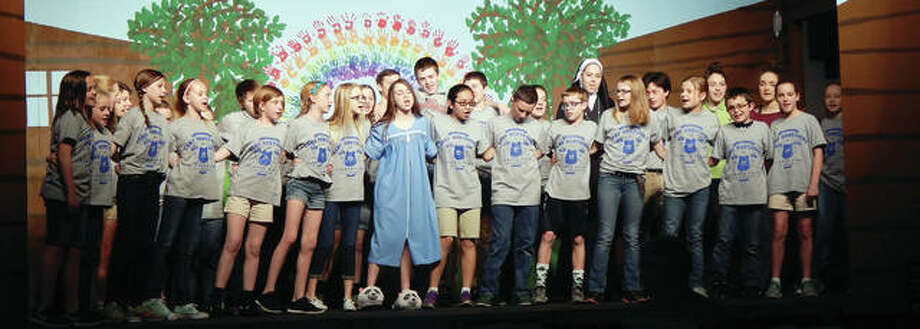 "The cast of ""Camp Ohmygosha"" gathers on stage for the final scene during rehearsals Tuesday at Our Saviour School. The play runs Friday and Saturday in the school gym. Photo: Angela Bauer 