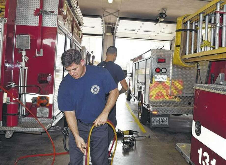 Fire Captain Mike Griffits helps pull out extraction equipment for maintenance Friday at the Jacksonville Fire Department. Photo: Samantha McDaniel-Ogletree | Journal-Courier