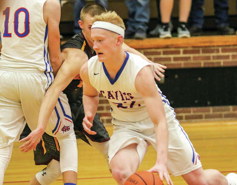 Carlinville's Joe Fraser, shown driving off a screen during a game earlier this month against East Alton-Wood River in Carlinville, scored 13 points Thursday night in the Cavaliers' loss to Staunton in the Carlinville Tournament. The Cavs will play for third place Friday. Photo: Nathan Woodside / For The Telegraph