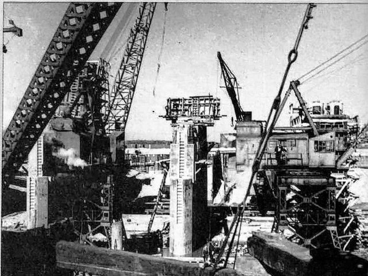 The activity involved in the construction of this dam was unbelievable. Crews of carpenters, steelworkers, concrete men, and engineers of all descriptions were busy doing their thing.