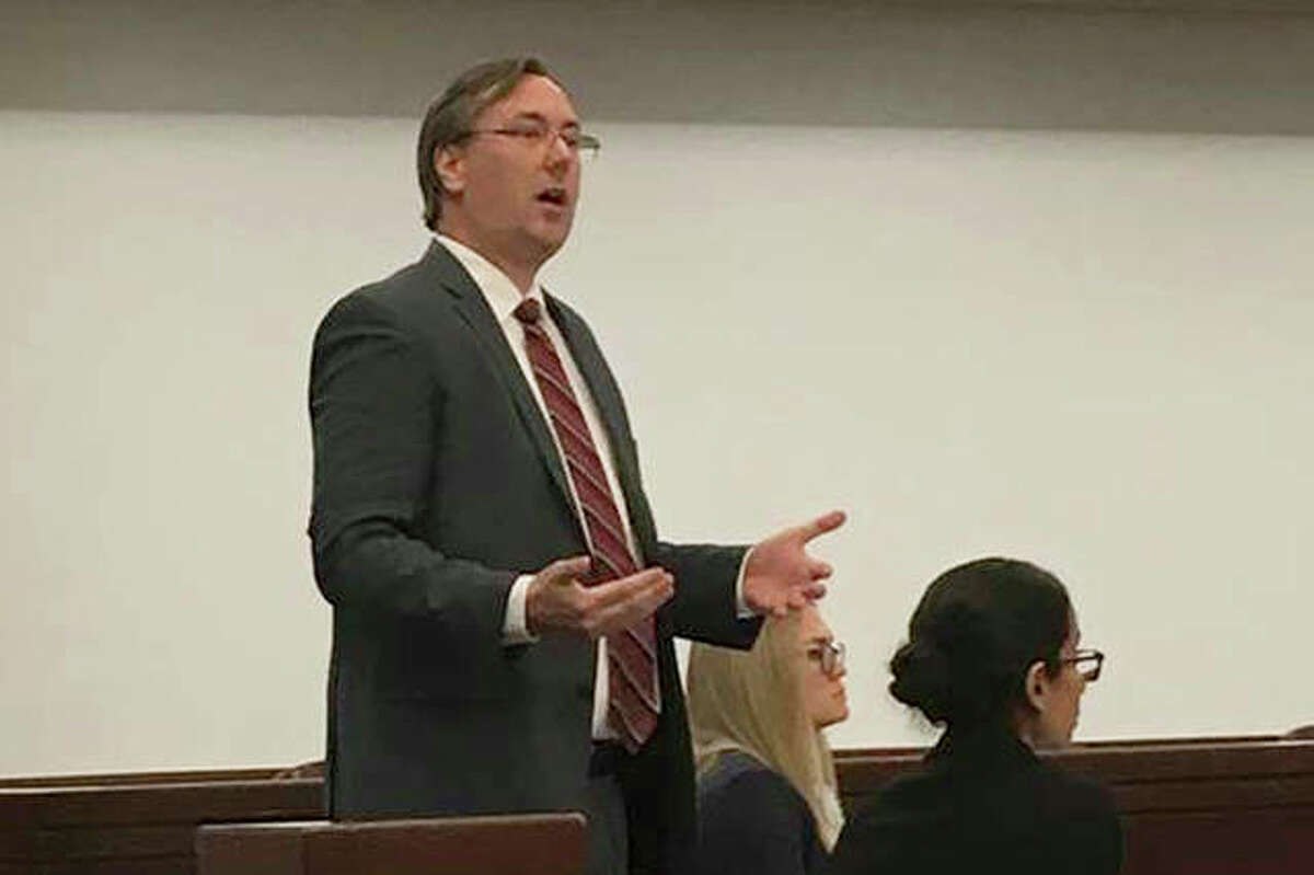 """Illinois Assistant Attorney General John Wolfsmith argues in Sangamon County Circuit Court in Springfield, Ill., Thursday, Dec. 28, 2017, against a lawsuit challenging a law allowing publicly financed abortions set to take effect Monday, Jan. 1, 2018. Wolfsmith said the plaintiffs in the case, 11 Christian and conservative groups and a dozen state legislators, were trying to stall for time by delaying implementation of the law to June 1. A judge dismissed the lawsuit, saying the plaintiffs' arguments are """"political questions"""" best left to the General Assembly."""