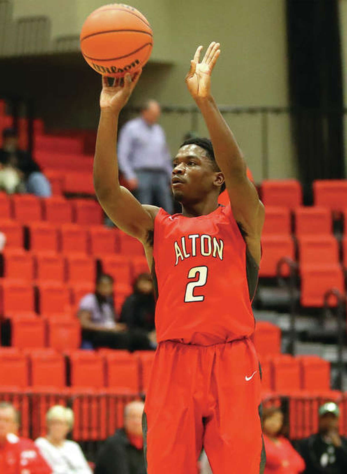 Alton's Kevin Caldwell, shown taking a 3 in a win over Granite City on Dec. 2 at SIUE, hit the game-winning 3-pointer Friday in the quarterfinals of the Centralia Tournament.