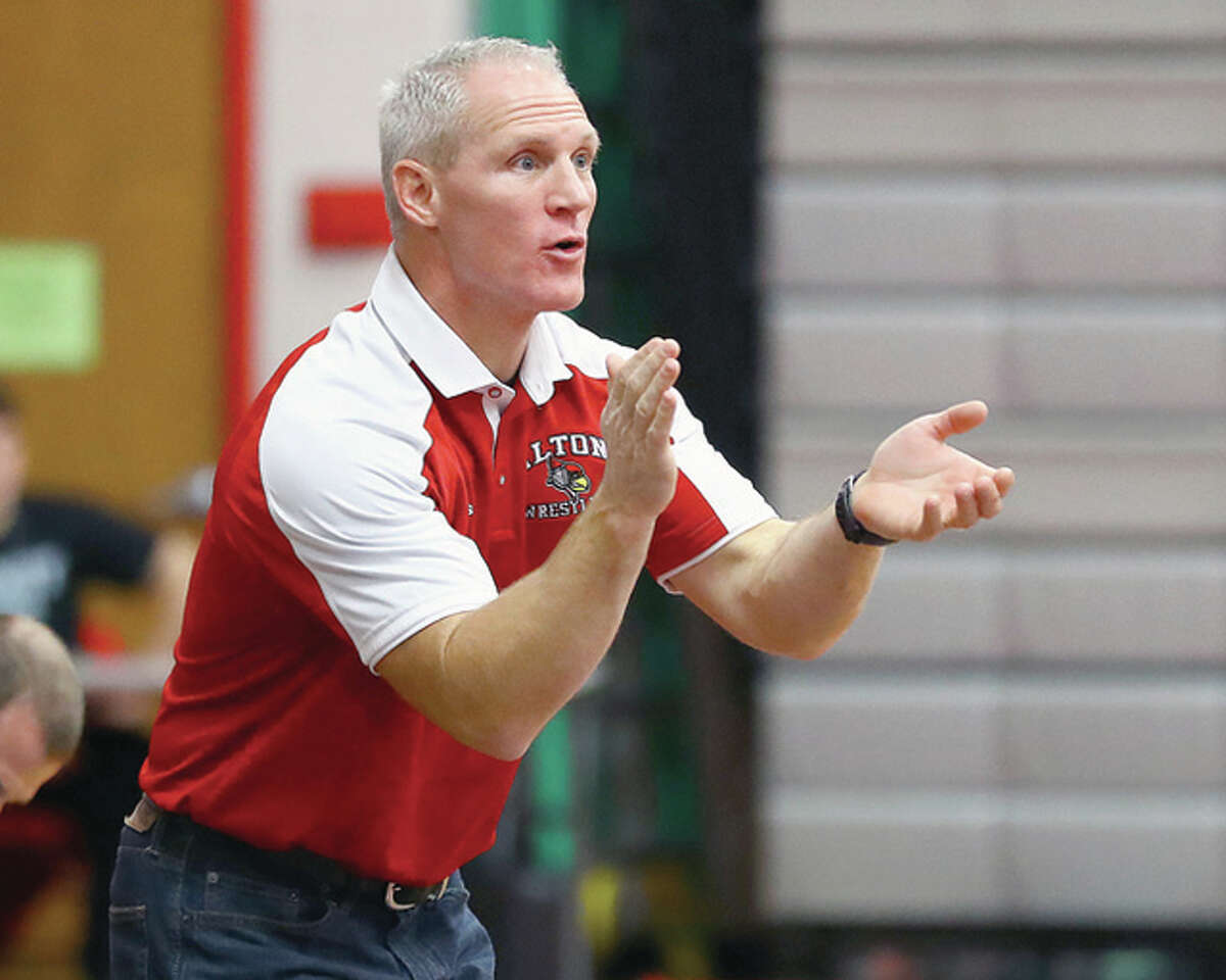 Alton wrestling coach Eric Roberson's team had a four top-10 finishers at the annual Red Schmitt Wrestling Tournament in Granite City, which came to a close Friday night. The Redbirds were 17th in the team standings.