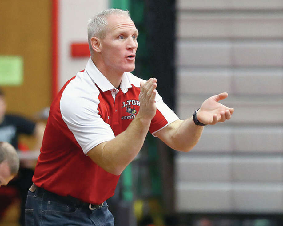 Alton wrestling coach Eric Roberson's team had a four top-10 finishers at the annual Red Schmitt Wrestling Tournament in Granite City, which came to a close Friday night. The Redbirds were 17th in the team standings. Photo: Telegraph File Photo