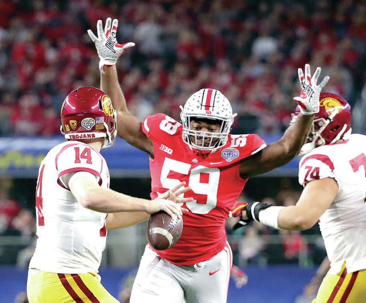 Ohio State defensive lineman Tyquan Lewis (59) closes in on Southern California quarterback Sam Darnold (14) during the Cotton Bowl Friday night in Arlington, Texas.