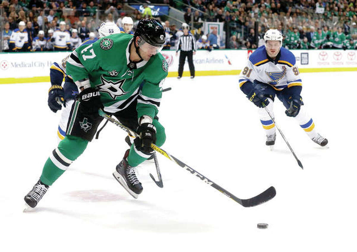 Dallas Stars right wing Alexander Radulov (47) and St. Louis Blues right wing Vladimir Tarasenko (91) chase the puck during the first period Friday night in Dallas.