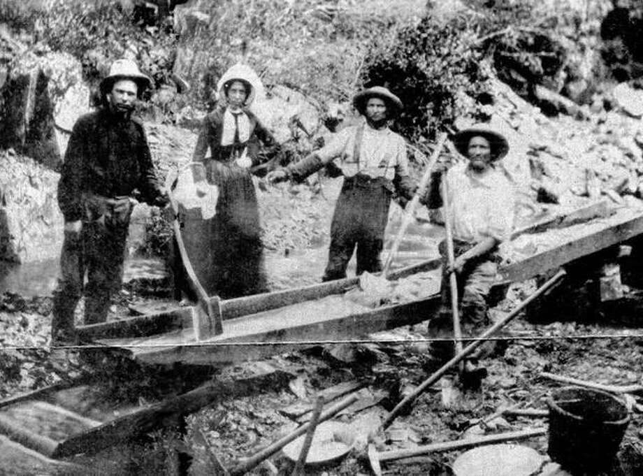 Prospectors look for gold in a California stream in the mid-1800s. Photo: File Photo